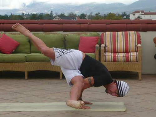Inverted side crow pose